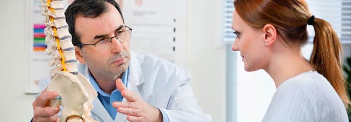 Chiropractic Boulder CO Chiropractor Educating Patient